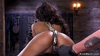 Ebony on wooden bench in strict hogtie