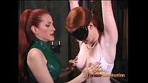 Latex-clad redhead wench has her way with a fre...
