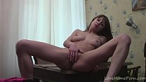 Brunette with big tits loves spreading her legs thumb