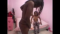 Horny black beauty fucks her girlfriend with a strap on in bed