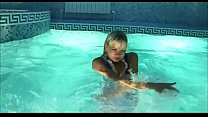Cute blonde model playing in the pool thumbnail