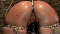 Babe ass oiled and hooked on hogtie صورة
