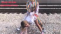 Clown fucks girl on train tracks