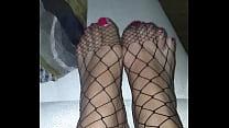 Goddess Cedez beautiful feet in fishnets.'s Thumb