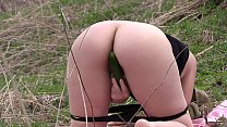Voyeur spies on a girl with a big ass that masturbates outdoors. Organic masturbation with cucumber. صورة