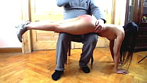 Red ass - spanking home in the livingroom thumb