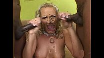 Horny Mandy Bright takes on 2 black mutant cocks