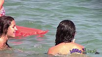 Two Italian girls playing under the water on the topless beach thumbnail
