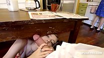 Daughter sneaks under the table to suck daddy's cock صورة