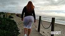 Girl with amazing ass takes a walk on the beach