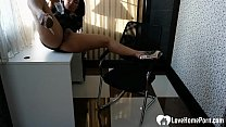 Naughty Asian masturbates while she's in the office صورة