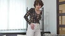 Euro milf Alice Sharp works her cunt with a dildo thumbnail