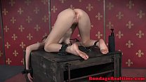 Whipped slave punished with dildo by dom