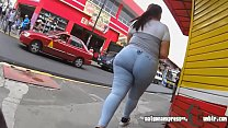 Brunette girl with huge butt walking down the street Thumbnail