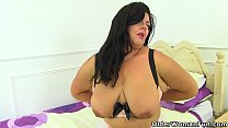 English milf Katie is ready for pleasure in her fine lingerie