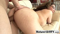 Brunette MILF in glasses seduces her nephew on the couch thumbnail