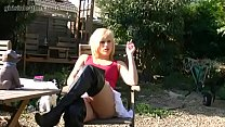 Kinky blonde smoking in leather boots and giving upskirt pussy close ups