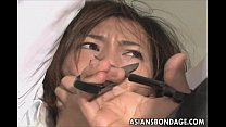 Cute Asian babe in electro play bondage scene
