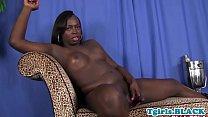 Ebony ts strokes her cock in highheels