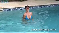 Super hairy curvy beauty at the pool spreading pussy and giving closeup views thumbnail
