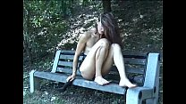 Walking naked on the wood jerks off her pussy