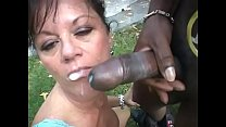 Horny ebony gangster allows cock hungry darkhaired cougar De' Bella to taste his banana yoghurt while he is istting in the sun lounger