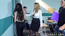 Busty MILF teacher gets with teen couple in her classroom Image