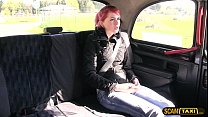 Unusual redhead babe rides a gigantic dick in the taxi preview image