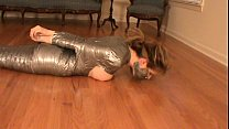 Girl mummified in duct tape, boobs, hands, feet loose