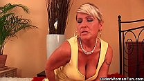 Grandma Renata with her hanging big tits is dildoing her hairy cunt