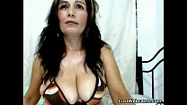 Busty MILF plays with her boobs on cam