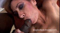 Amateur mature milf taking a big black cock in Interracial Video Image
