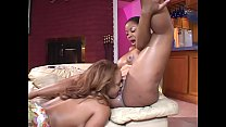 Two black lesbian in bed cunt suck each other and play with dildos