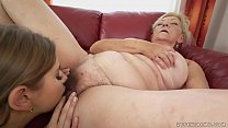 Saggy titted granny licking young pussy