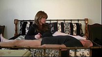 Mistress masturbates lucky man while on the bed preview image