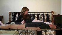 Mistress masturbates lucky man while on the bed