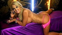 6858 Hot busty blonde telephone sex girl in pink dress preview