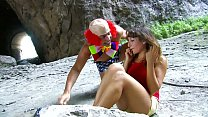 Busty babe gets fucked by clown outdoors
