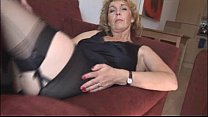 Image: Mature blonde babe in stockings and open girdle