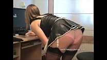French maid in stockings cleaning the office