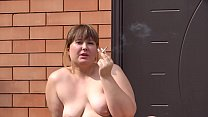 Naked BBW with fat pussy smokes outdoors and at home. Amateur fetish and close-up face.