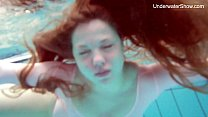 Redhead Simonna showing her body underwater Image
