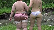 Squirt hairy pussy. Two Russian lesbians with big asses masturbate outdoors.