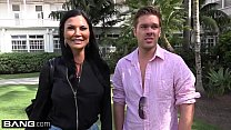 Jasmine Jae is a hot MILF with big tits and a pierced clit. The trio go to the beach where Jasmine exposes her pussy for the public to see! porn image