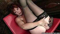 Redheaded milf Amber Dawn looks so slutty in black lingerie Image