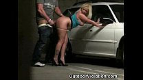 girl with busty body bent over in public garage