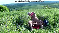 A blossoming meadow and nude couple fucking in the middle