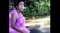 village girl bathing in river showing assets www.favoritevideos.in Image