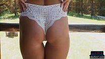 Blonde MILF hottie Elyse Jean stripteasing outdoor