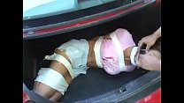 Bursting To Pee, Sexy Kidnapped Girl Can't Hold It Anymore In The Trunk صورة